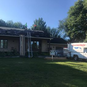 Professional working on roof repair