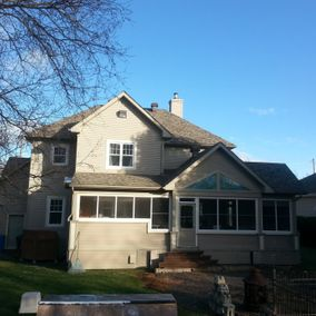 Exterior view of a house after roof repair
